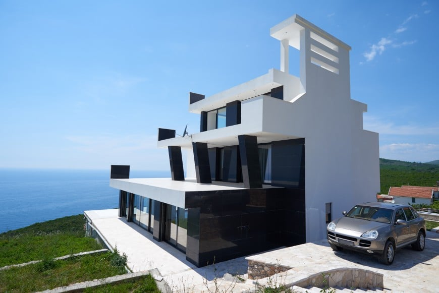 This contemporary home is located atop a hill with a beautiful view of the ocean.