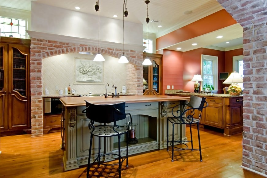 This traditional kitchen design features an island counter and a beautifully designed cooking area