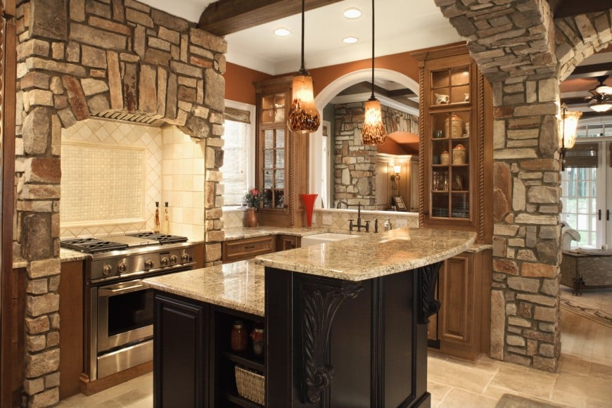 kitchen area with an island counter and stone-clad walls