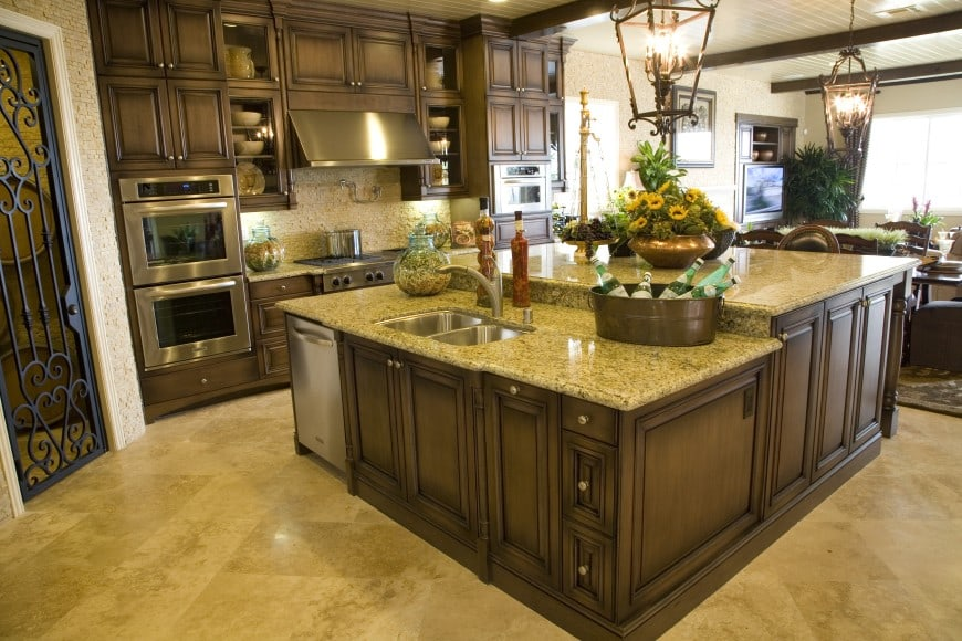 Have a look at one more traditional kitchen design in dark-toned wood and speckled granite