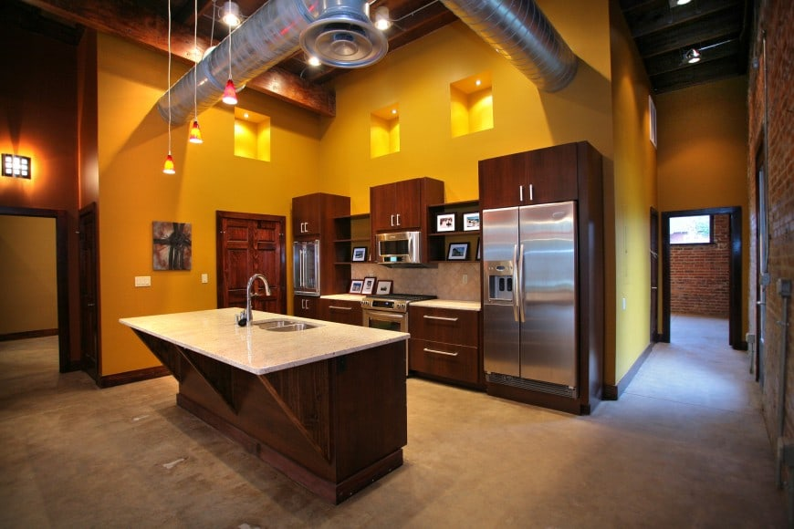 This design has a cool industrial feel to it with its exposed HVAC pipes running overhead