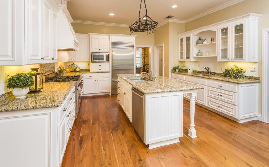 The prime color here is white and it's matched with hardwood floors, beige-toned walls, speckled granite countertops