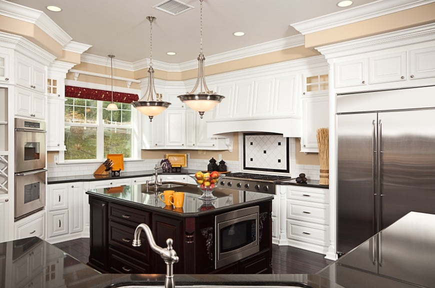 This black and white kitchen design features glossy finish countertops, raised panel doors and traditional details.