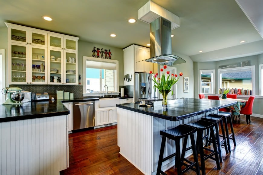 Here, the cabinets have beadboard doors that inspire a cozy rustic feel