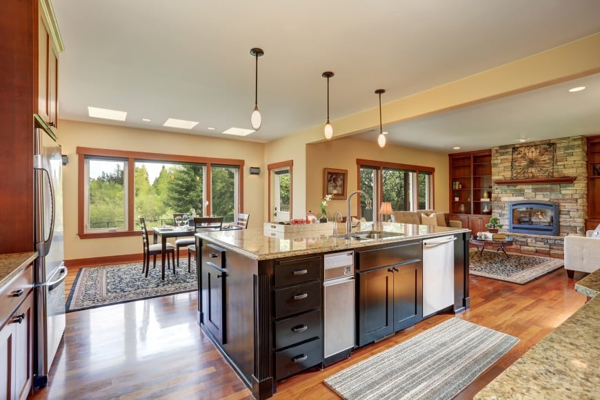 his L-shaped kitchen has a traditional appeal and features a massive island counter with a sink