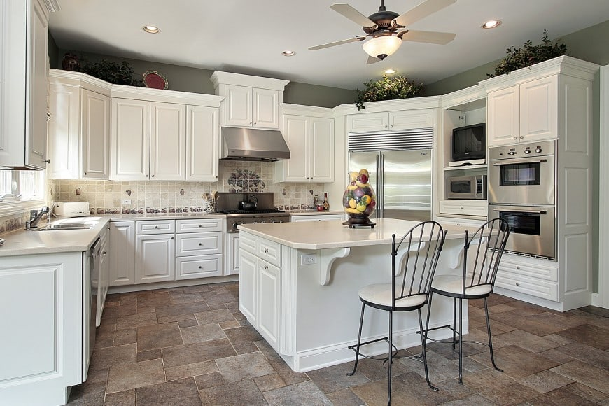 This U-shaped kitchen design with an island counter is just as beautiful as it is practical and convenient.