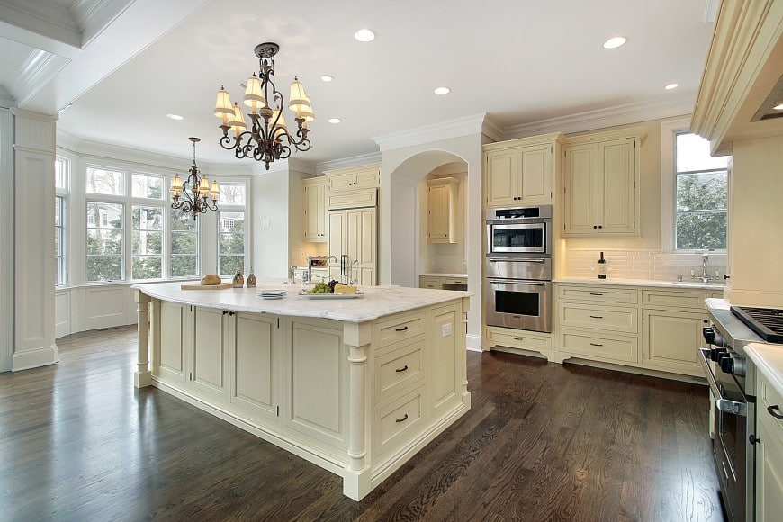Eggshell color is a nice alternative to plain white and is a great choice for a traditional kitchen design such as this one