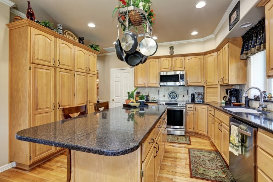Here is one more kitchen design set in wood, only a little bit lighter this time