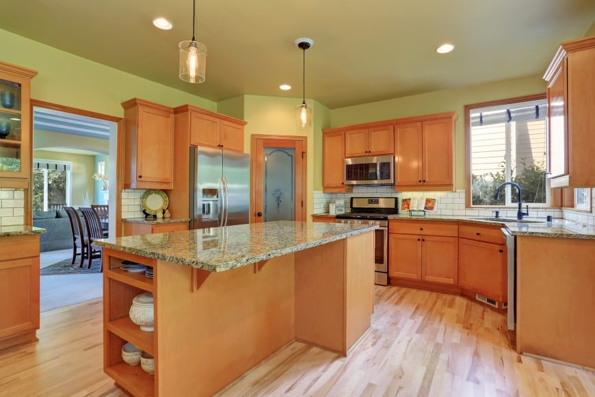 This kitchen may be simple in design, but it is quite convenient with its practical layout and large island counter