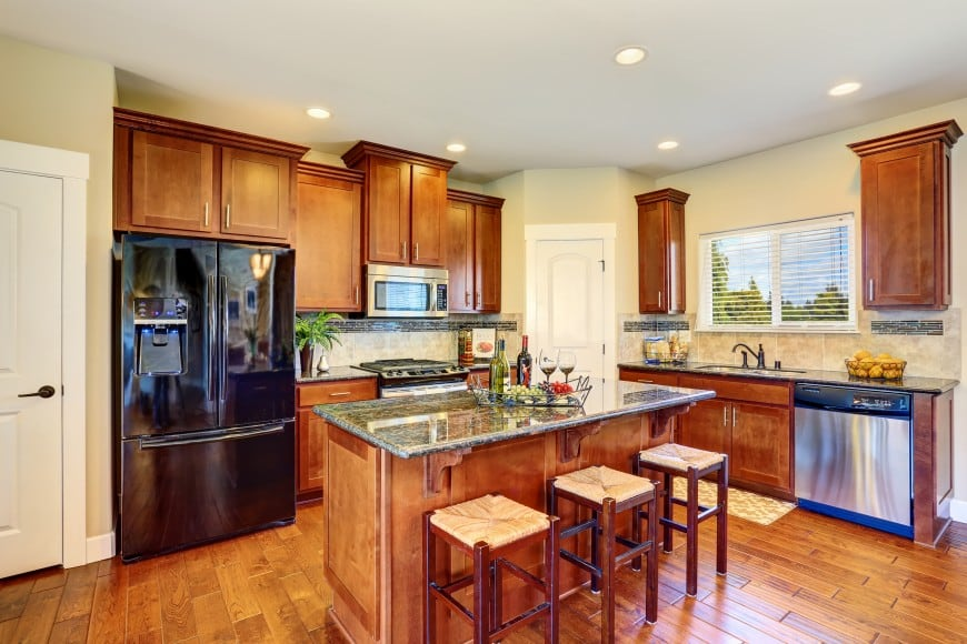 Have a look at one more cozy kitchen design that is set in wood.