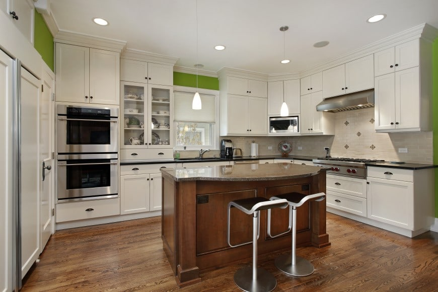 This transitional design features white cabinets with black granite countertops