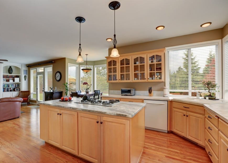 Here is a convenient kitchen area that accommodates a larger living space featuring dining and living room areas