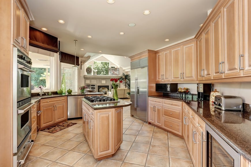This traditional kitchen has an oddly shaped floor plan.