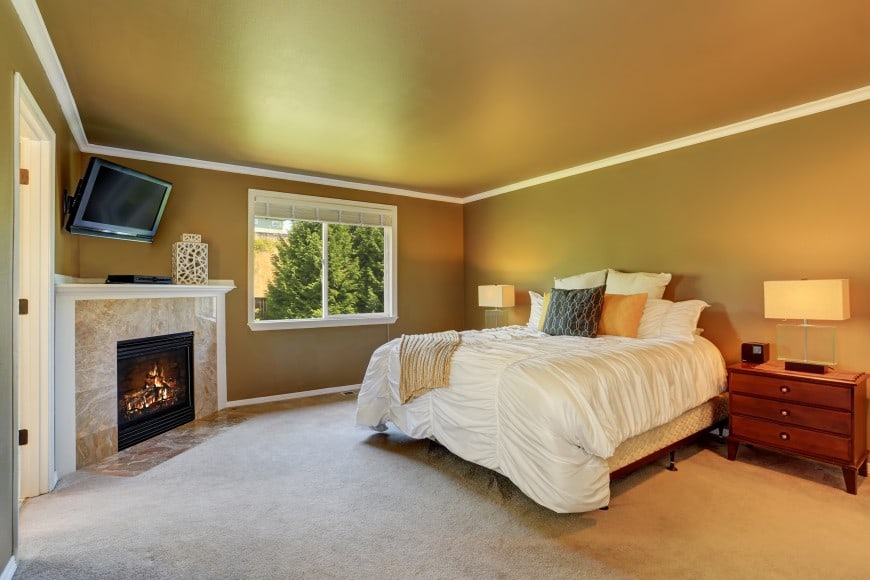nice and cozy bedroom with fireplace in the corner