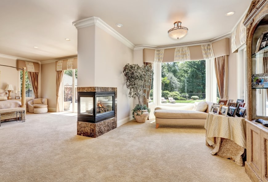 modern-looking room-dividing fireplace in master bedroom