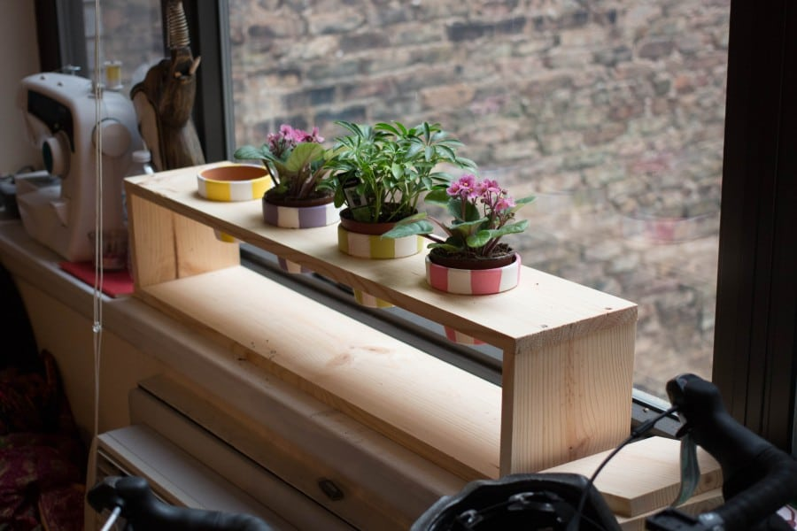 planks planter next to window
