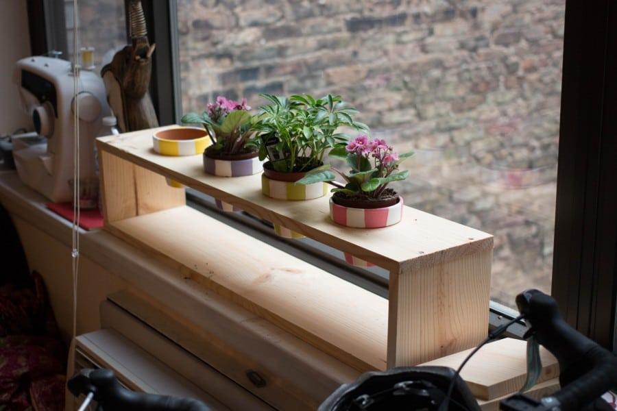 planks planter next to window