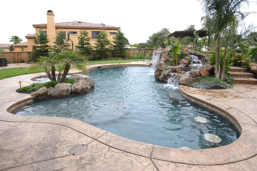 Swimming Pool Design With A Waterfall Feature.
