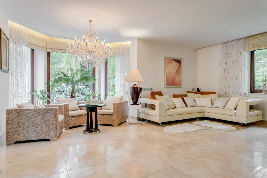 Lighting options include a table lamp, accent LED strip lighting, and a luxurious crystal chandelier.