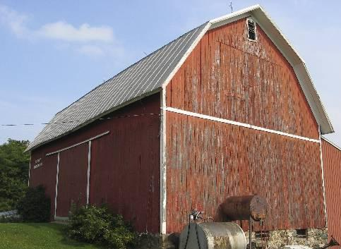 A Gambrel Roof Often Appears On Barns And Farm Houses. It Contains Two  Different Slopes, With The Lower One Being Steeper Than The Other One.