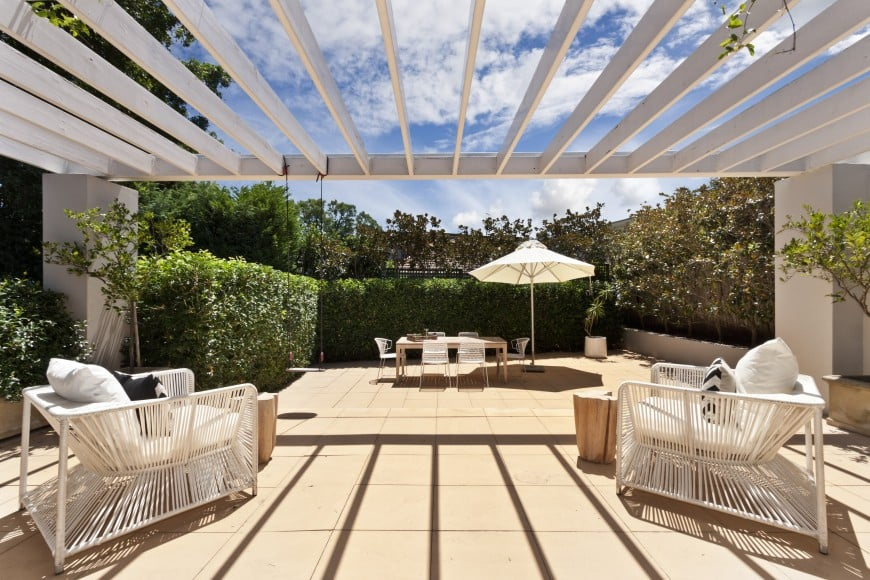 backyard with white wooden pergola