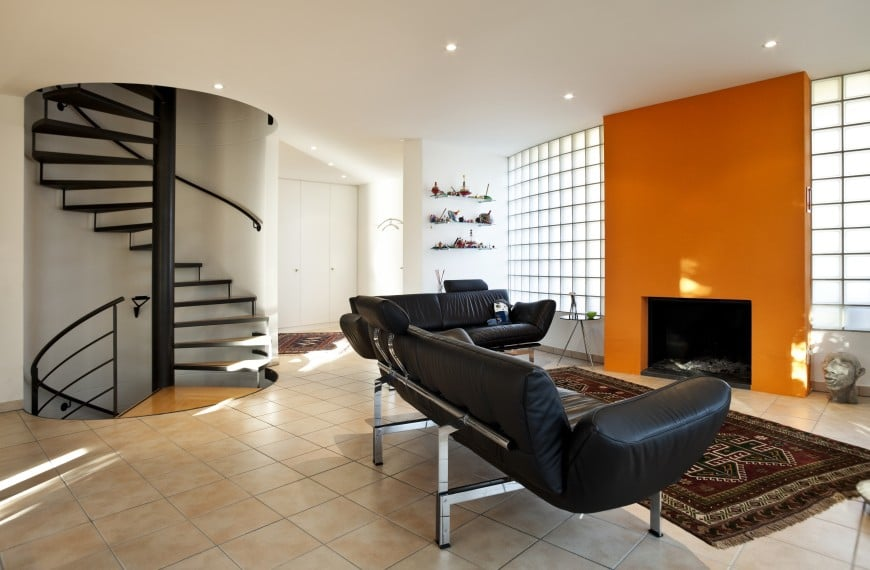 This Modern Design Has A Bold Feature Wall In Orange That Strikes The Eye At First Sight Set Of Leather Sofas Forms Neat Conversation Area