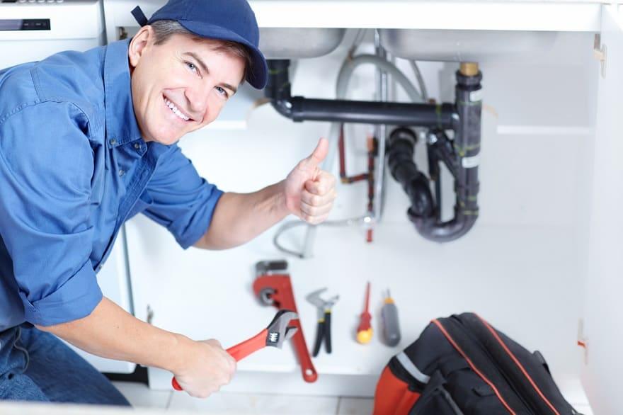man fixing plumbing