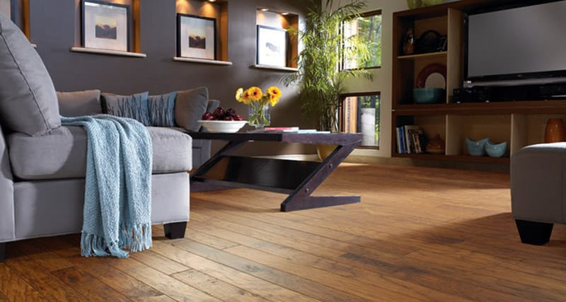 A room with hickory wood flooring.