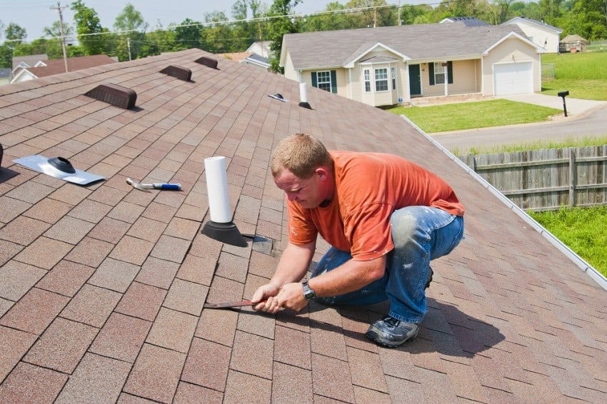 worker restoring a roof