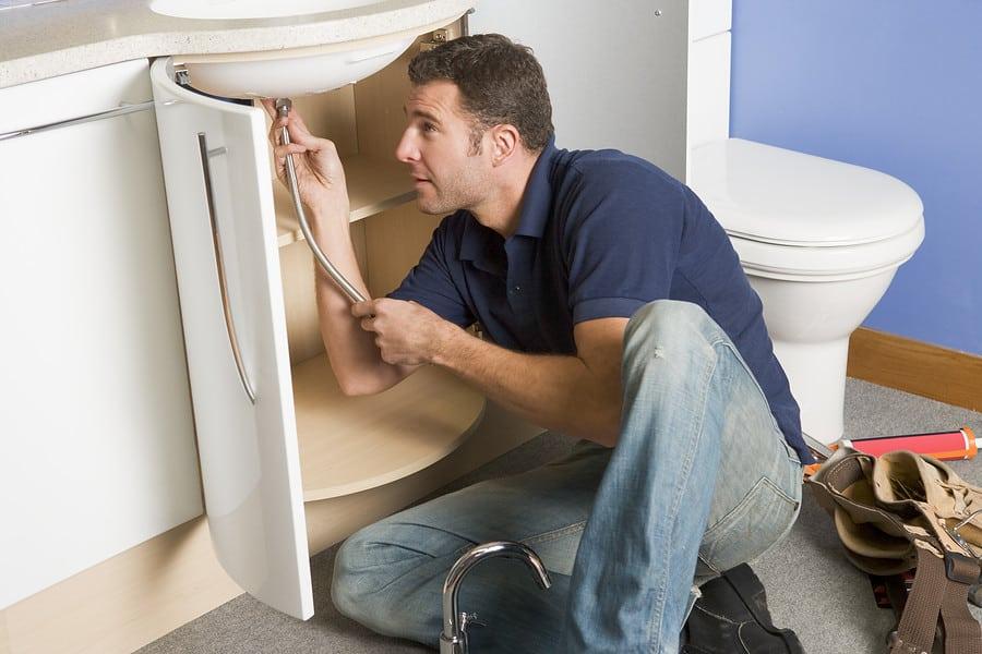plumber checking sink