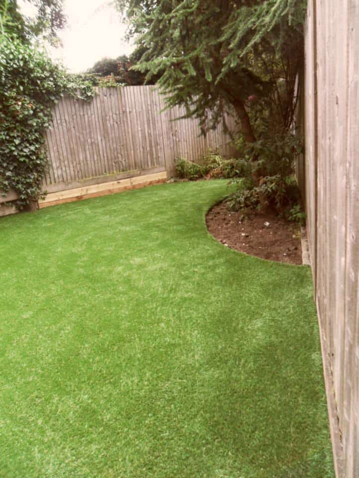 green synthetic grass in backyard