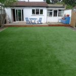 A layer artificial grass in the backyard