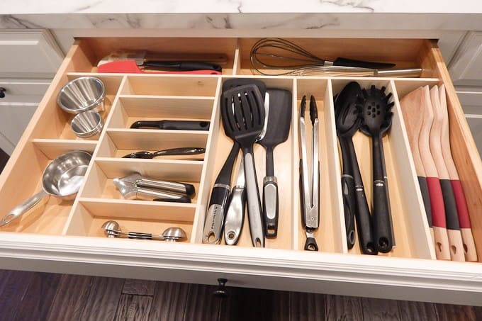 Utensils organized in a kitchen drawer with separations