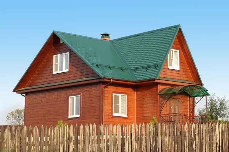 green metal roof on wooden home