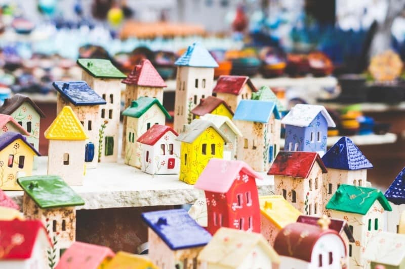 An arrangement of colorful ceramic miniature houses