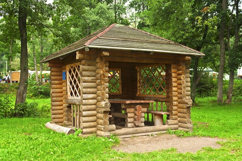 Wooden gazebo for relaxing standing in the forest