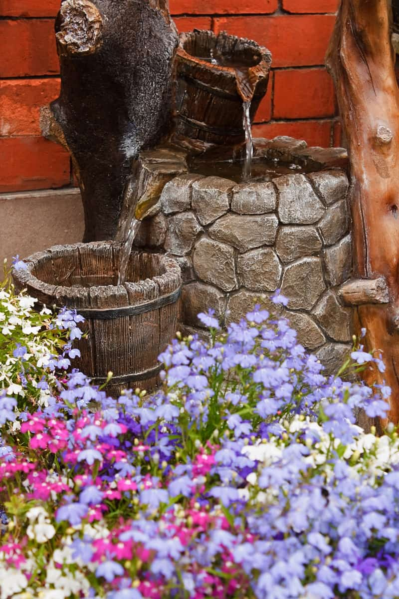 small residential paved garden water feature or waterfall