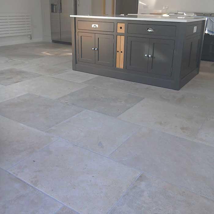 gray limestone floor in kitchen