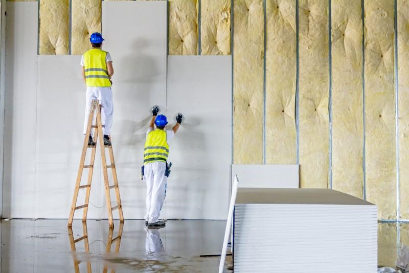contractors installing drywall