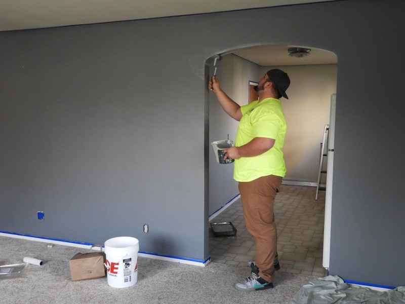 painter working on the interior walls