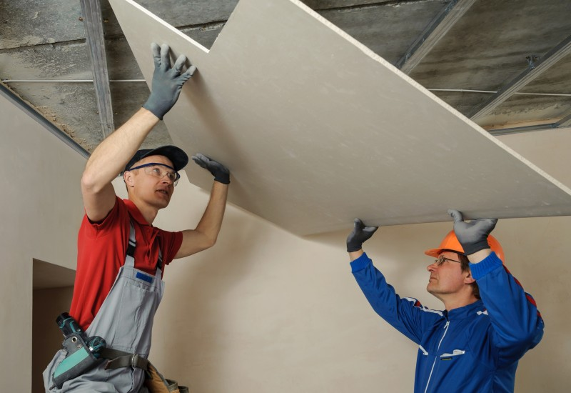 installers putting ceiling drywall