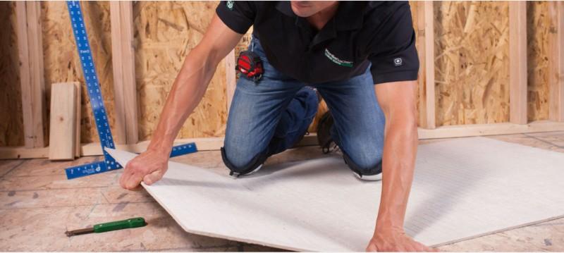 man installing hardie backer board